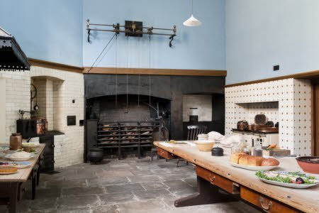 The Great Kitchen at Tredegar House, Newport, South Wales. The walls are partly tiled with 1880s Maw and Company tiles, with the upper parts painted blue which was a colour believed to repel flies.