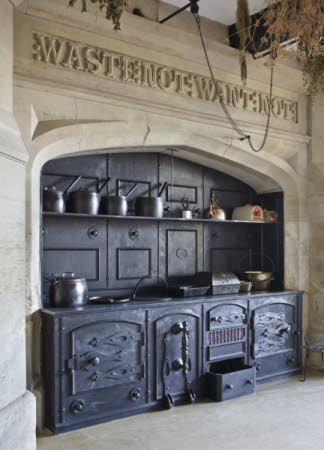 The range and surrounding stonework with carved inscription in the Kitchen at Gawthorpe Hall, Lancashire.