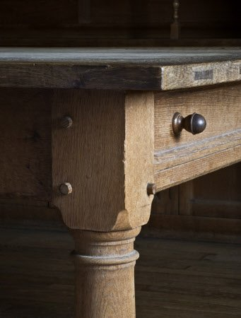 Partial view of the oak table designed by Lutyens and made by Dart & Francis in 1927 in the Butler's Pantry at Castle Drogo, Devon.