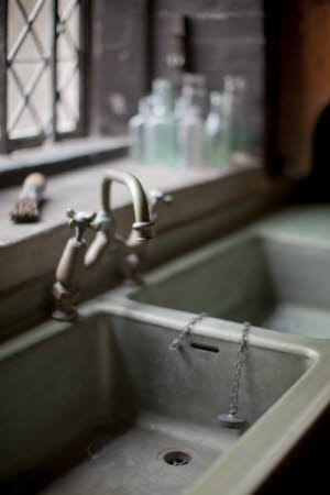 The double sink and taps in the Scullery at Dunham Massey, Cheshire.