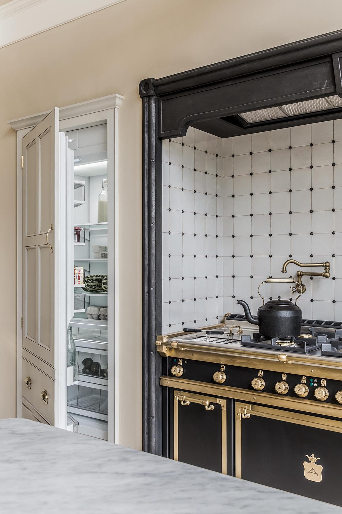 This recessed cupboard conceals a fridge. The other hides a microwave and pot storage.