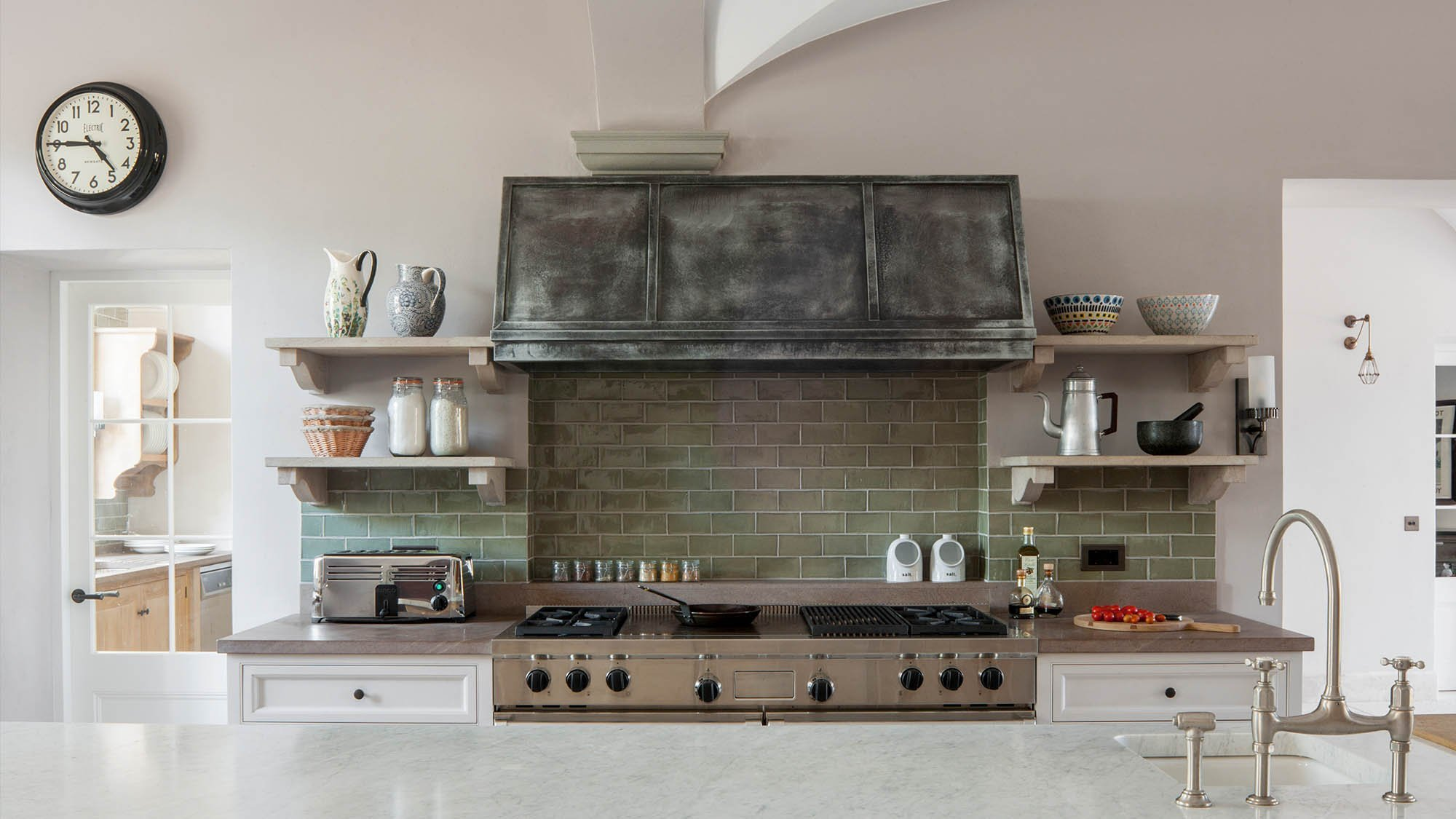 Wolf range oven with bespoke aged extraction hood