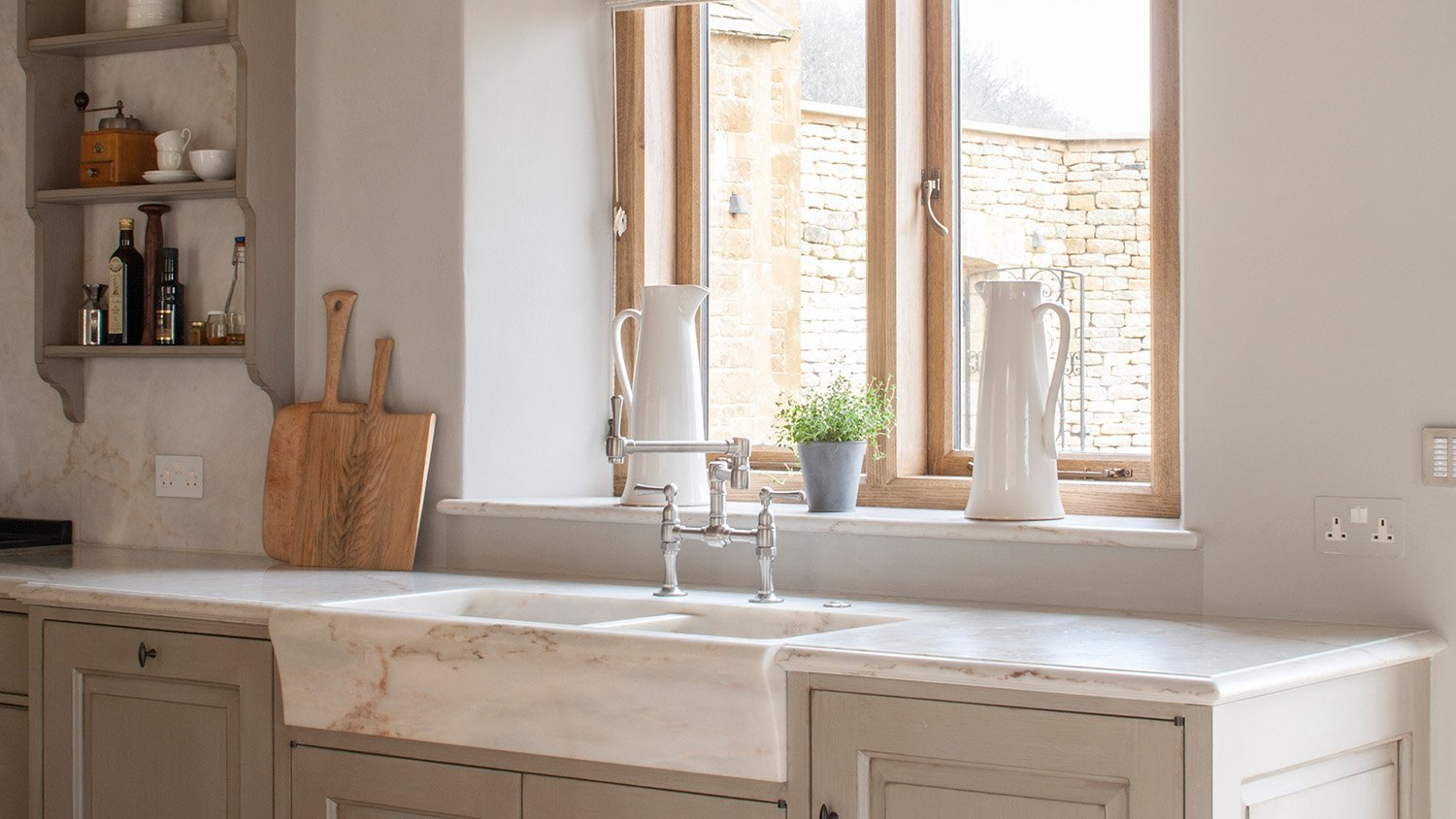 Solid Portuguese marble sink with a bullnose waist
