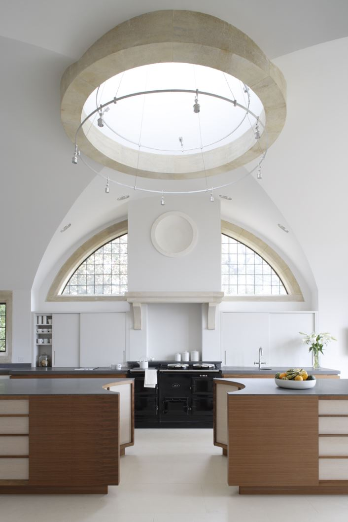 The shape of these two islands reflects the roof lantern above.