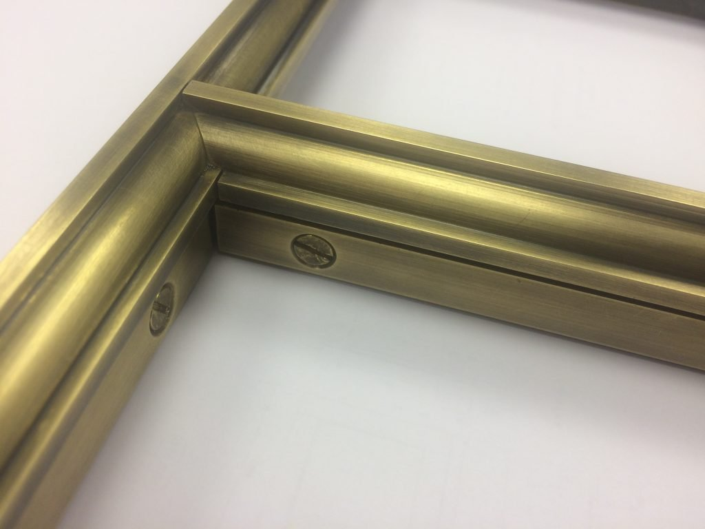 detail of brass window frame for kitchen
