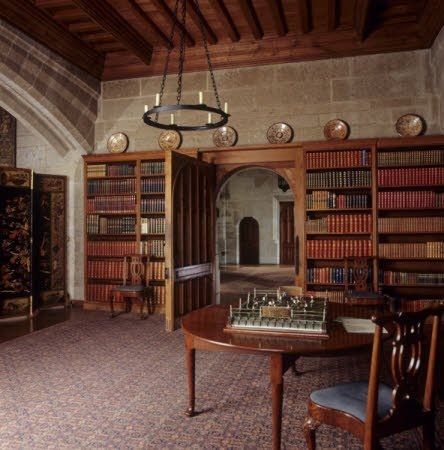 Looking through the Library door toward the Entrance Hall at Castle Drogo, Devon.