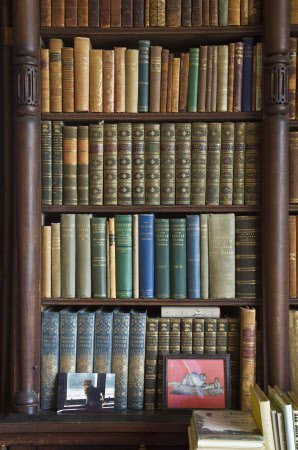 Shelves in the Library at Scotney Castle, Kent.