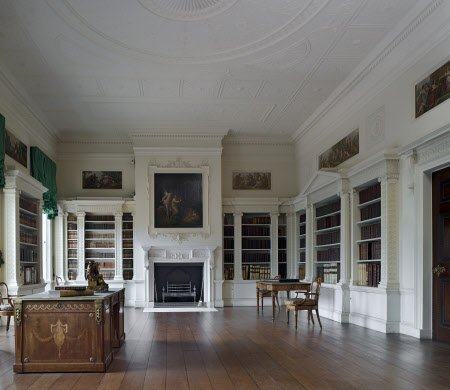 The Library, designed by Robert Adam in 1766, at Osterley Park, Middlesex. The room is in a stony white with neo-classical details, the original collection of books would have had colourful bindings and the simplicity of the room was in sympathy with that. In 1885, the original library volumes were sold to pay for the refurbishment of the house.