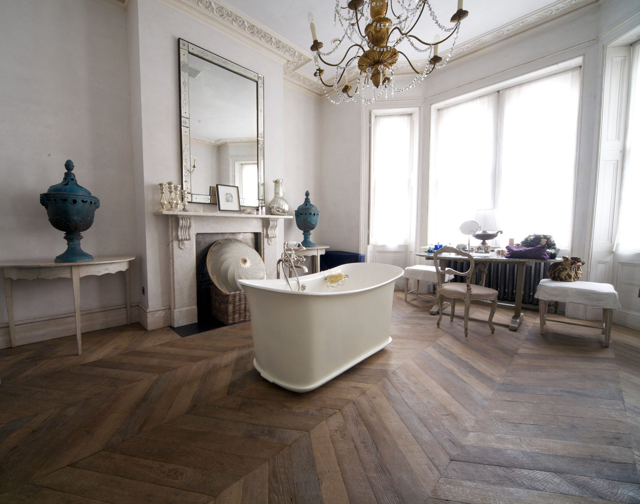 Bathroom with a slipper bath and dark wooden floor