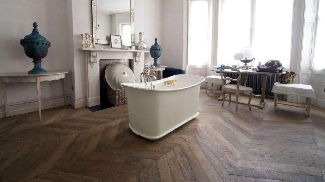 Slipper bath on wooden oak floor