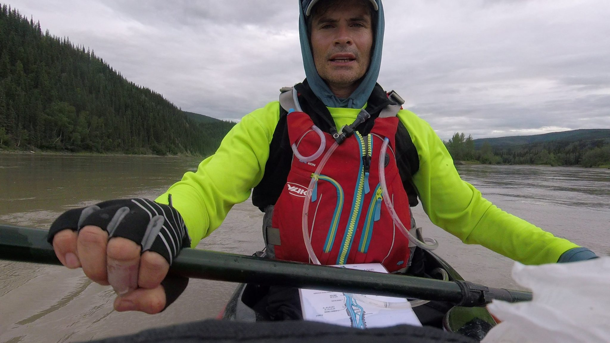 tim hellier in a canoe on a wide river