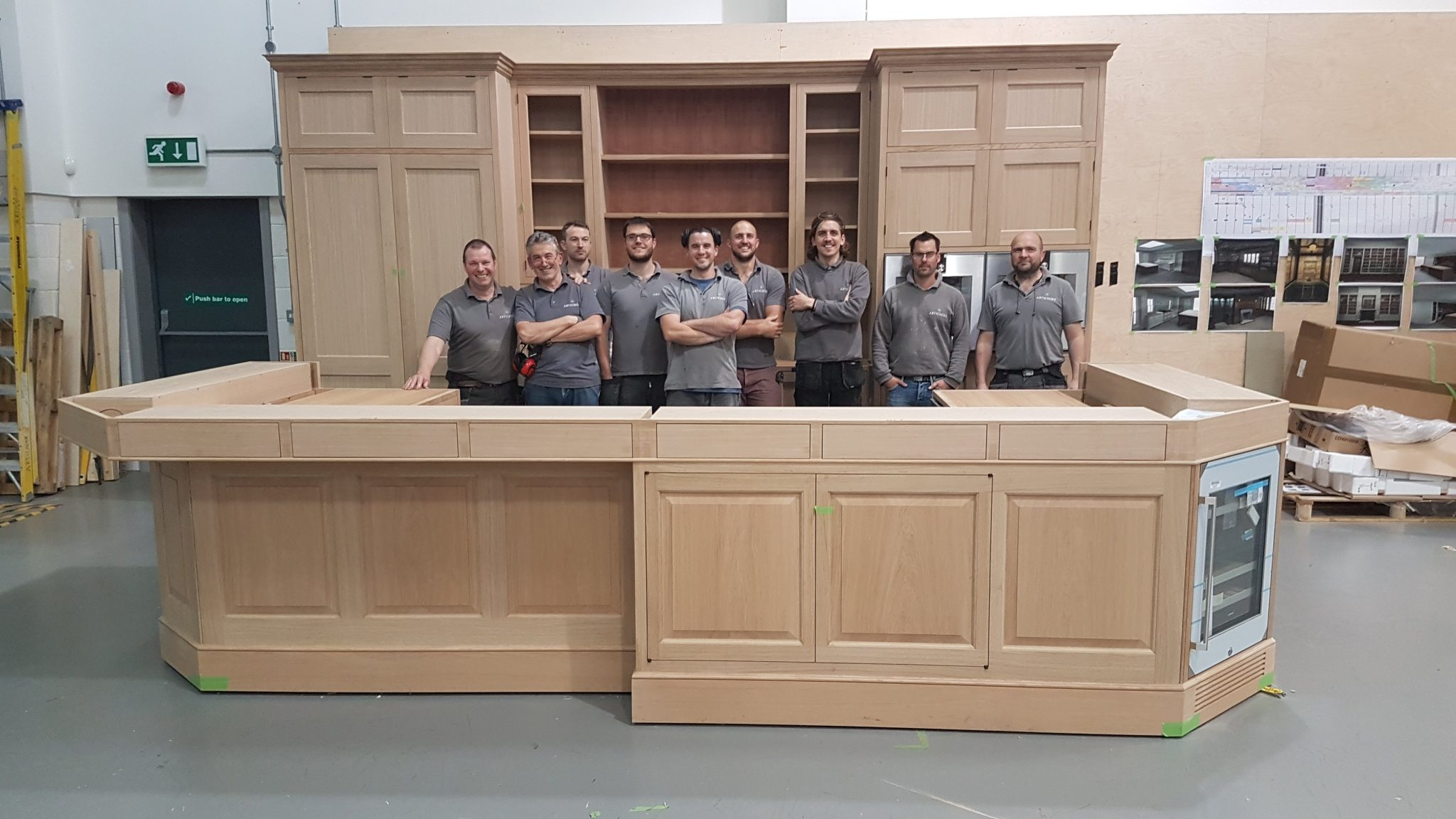 Kitchen cabinet makers behind their work