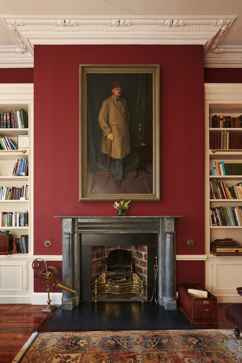 grand painting above fireplace