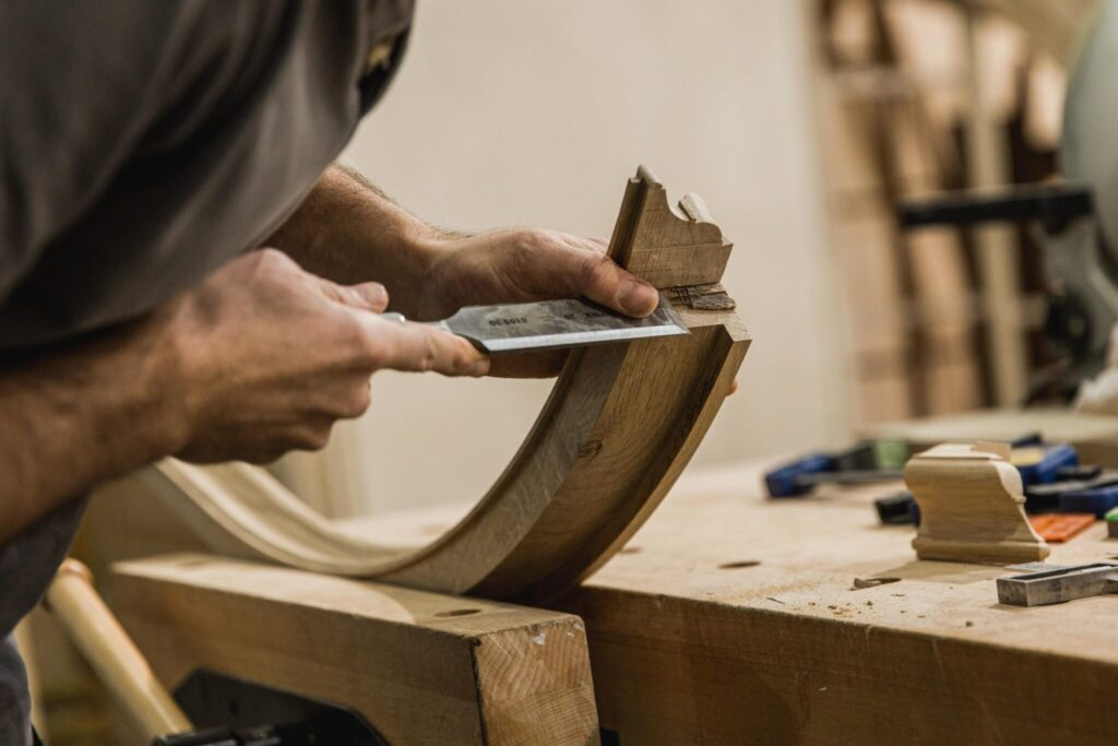 cabinet maker using a chisel