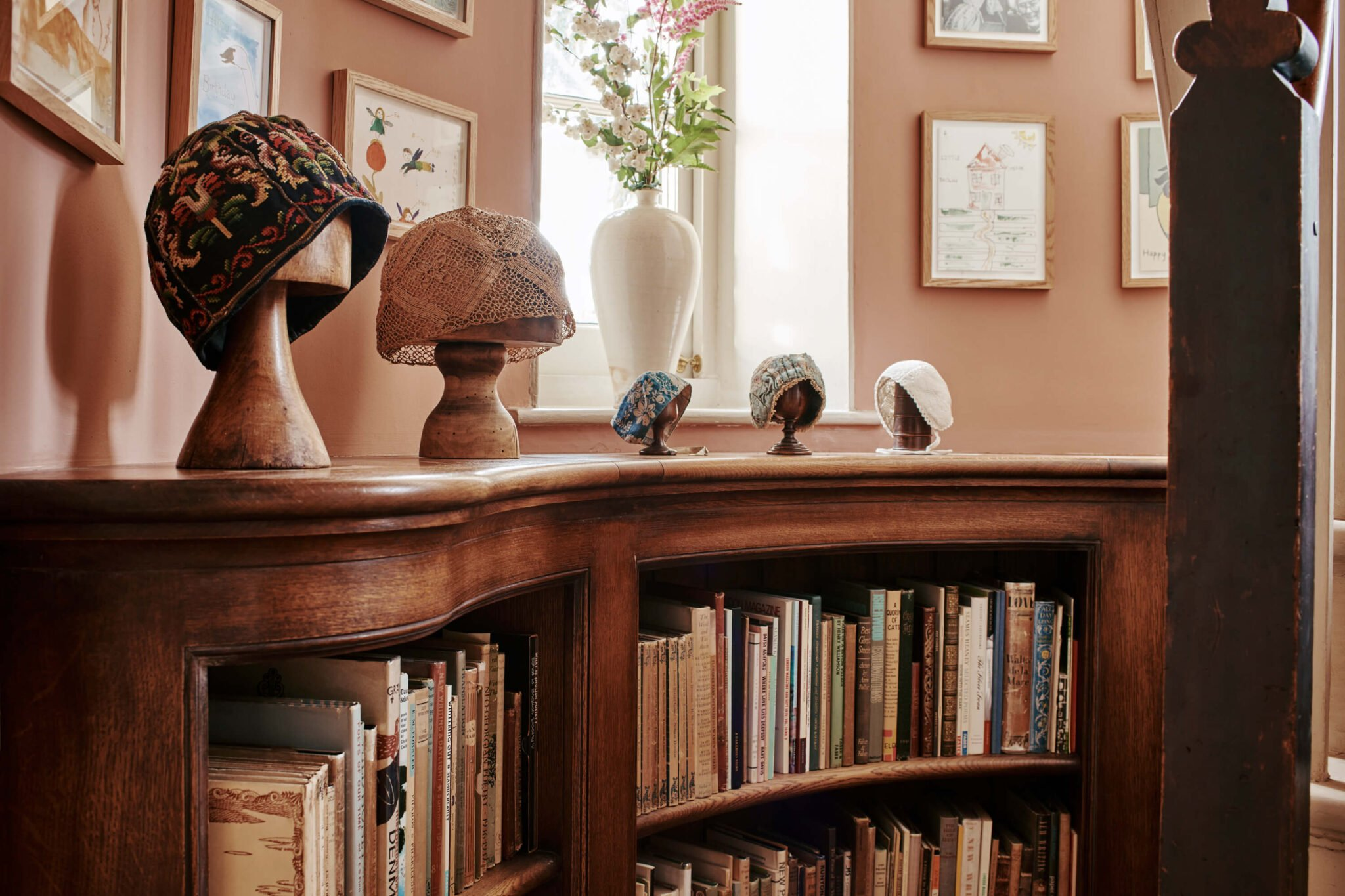 Bookcase with hats on show