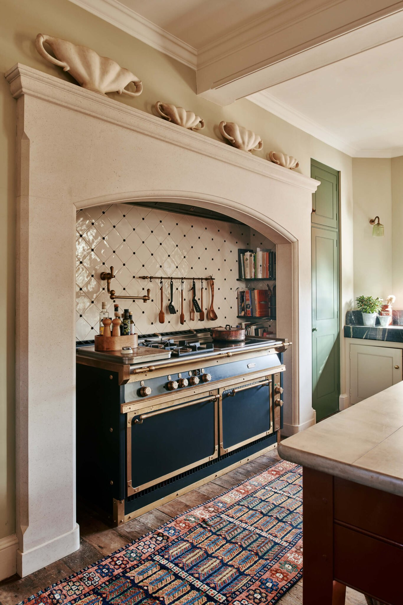 Large range oven in Limestone fireplace