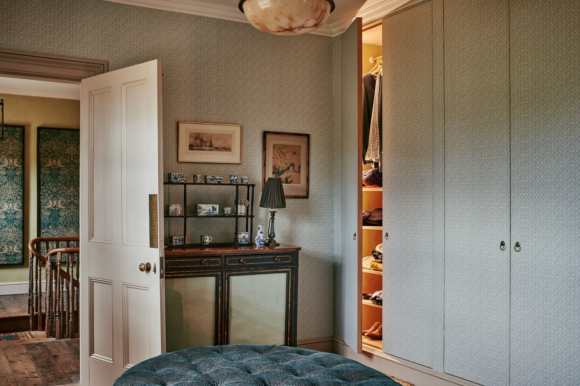 bwedroom wardrobes with wall paper